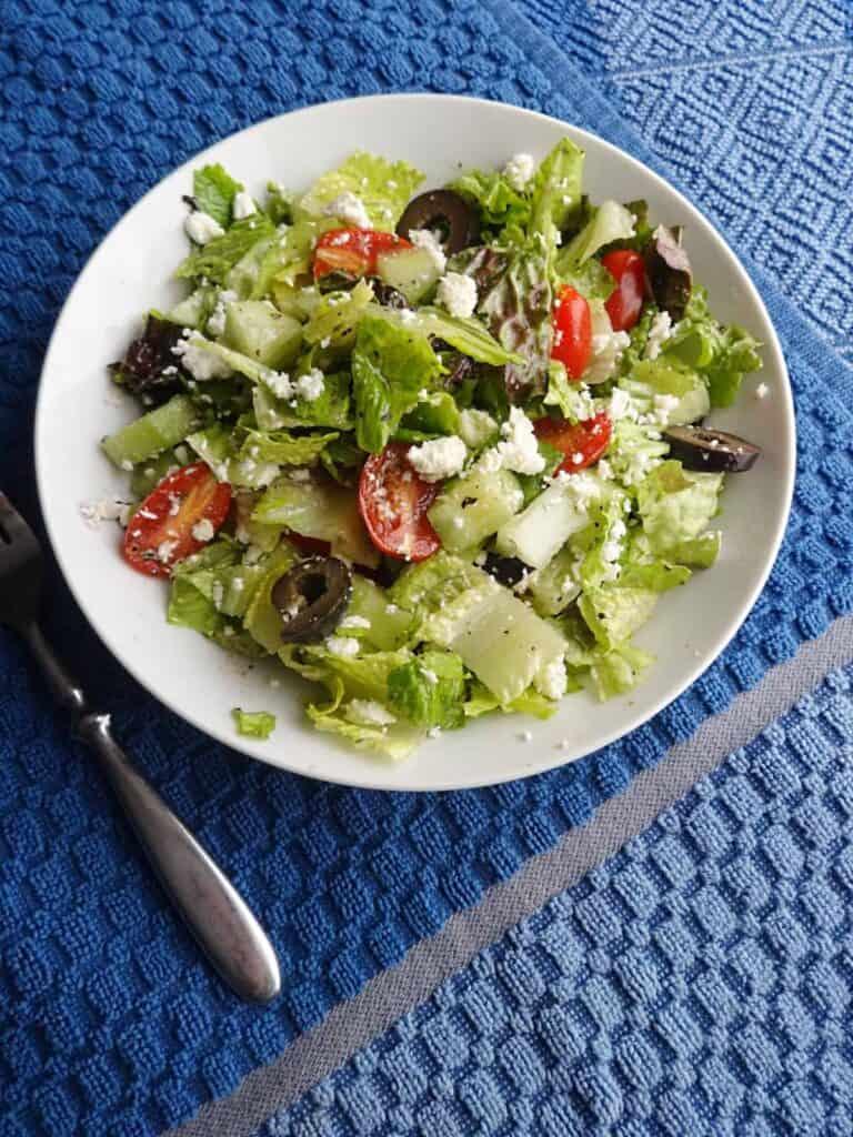 Mediterranean salad in white bowl