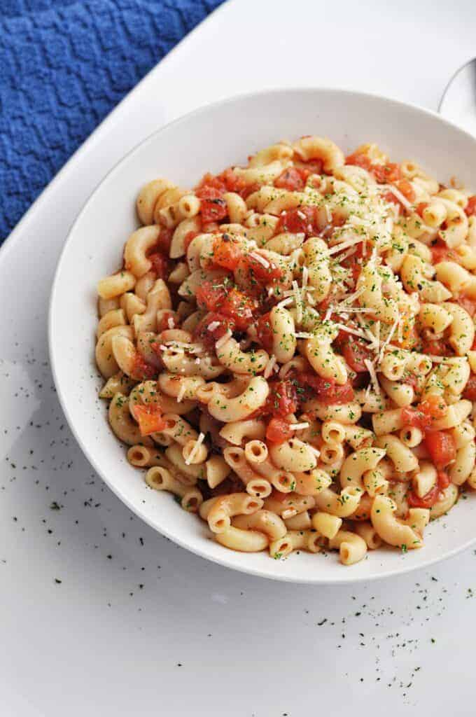 Macaroni & tomatoes recipe in white bowl