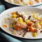 Soup with chicken corn and potatoes in bowl