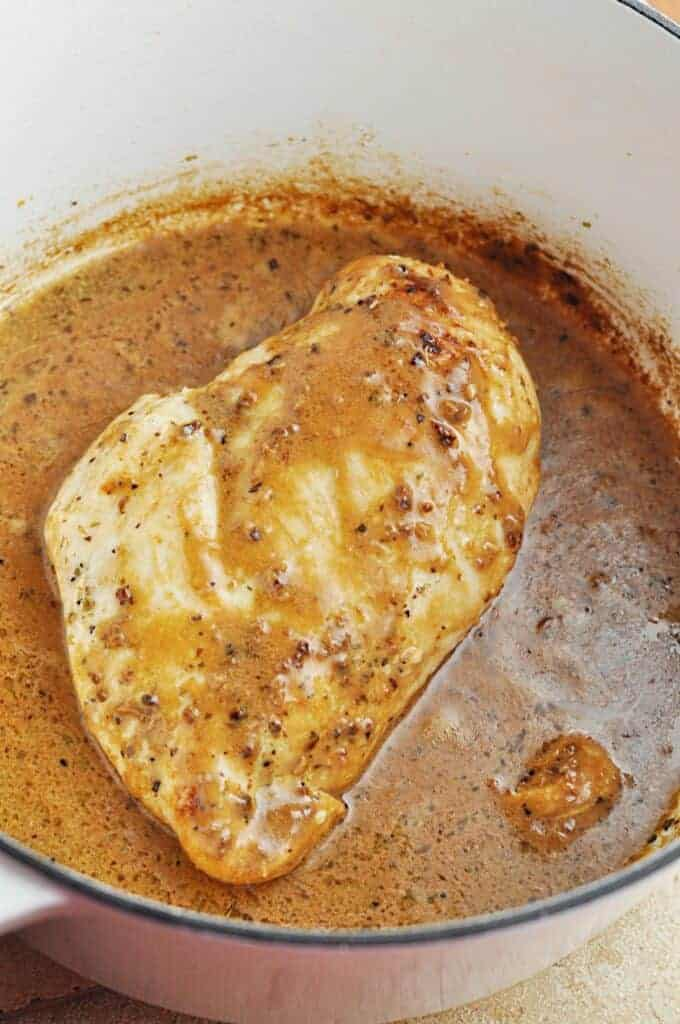 Chicken cooking in buttery garlic sauce