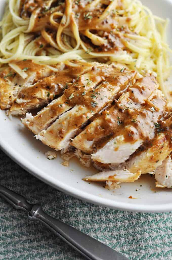 Chicken with luscious sauce over pasta