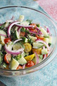 Mediterranean Cucumber Salad ready to serve in clear bowl