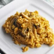 Pumpkin risotto with mushrooms on serving plate