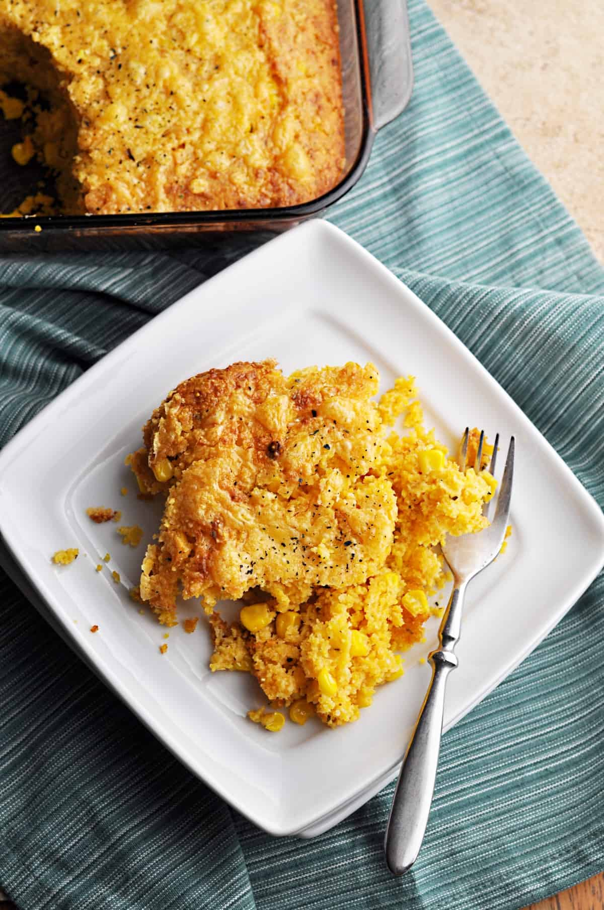 Sweetcorn casserole on white plate with fork