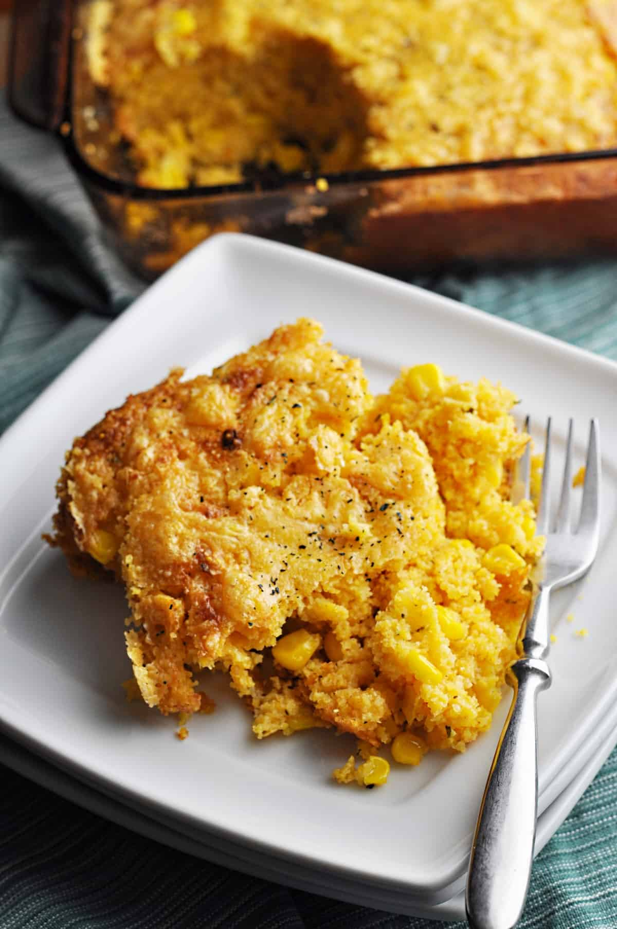 Casserole with corn on plate fresh from oven