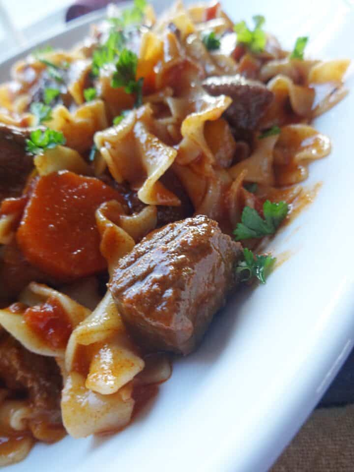 Beef goulash served with noodles