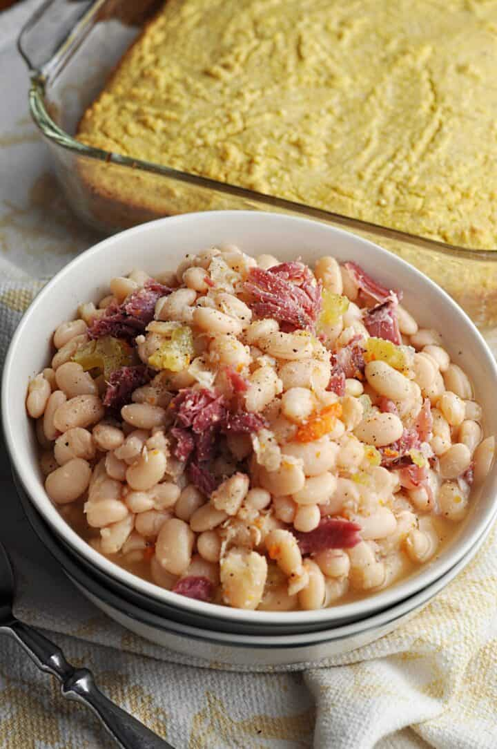 White beans in a bowl served with corn bread