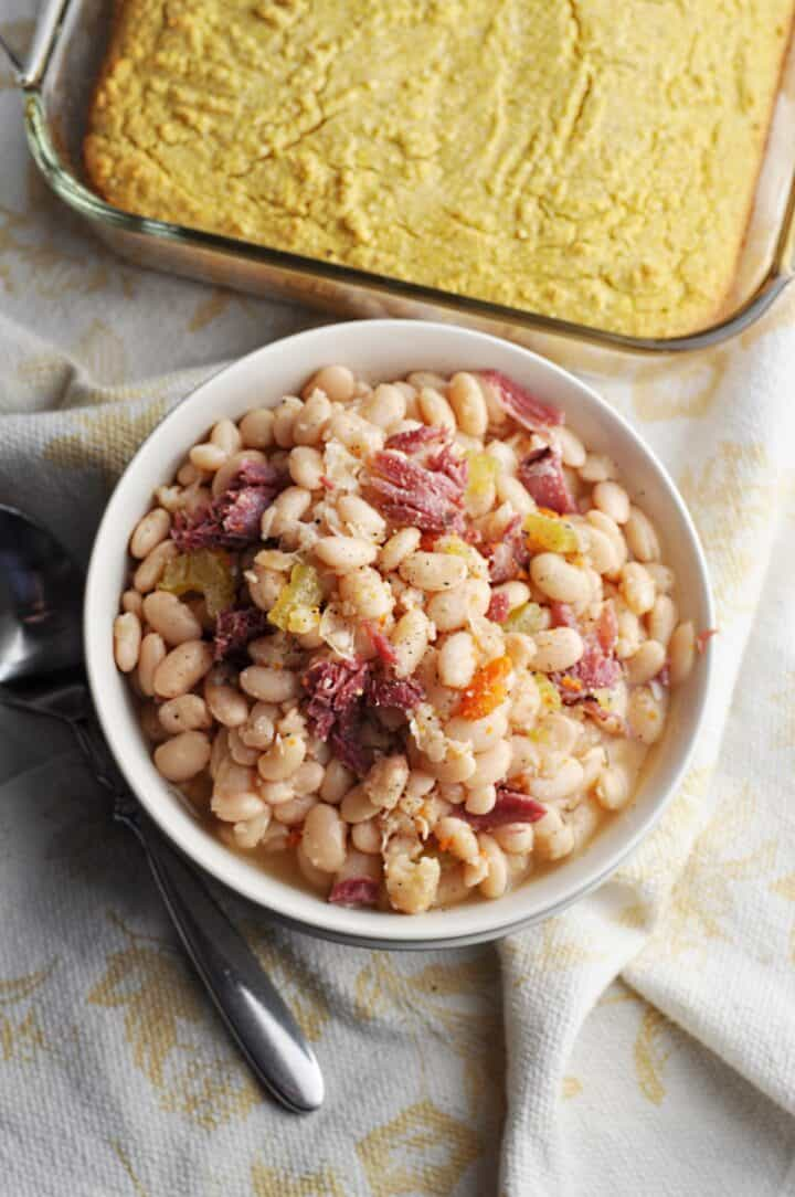 Beans with ham and carrots overhead shot in bowl