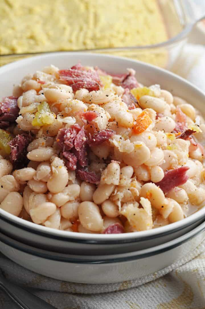 White beans with ham and carrots in bowl