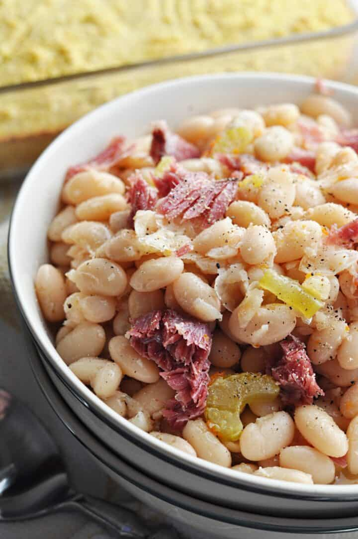 Great northern beans with ham close up in bowl
