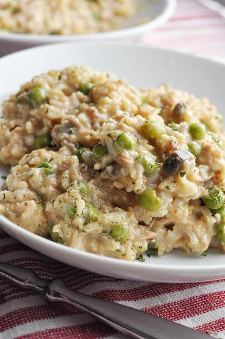 Serving of tuna casserole with rice and peas
