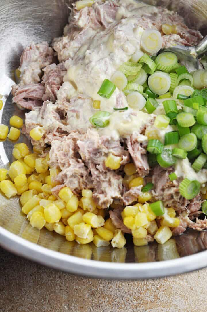 Ingredients in bowl for tuna salad with pasta and corn