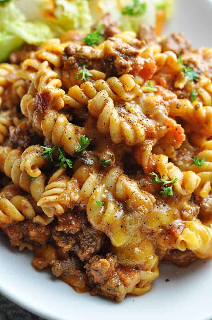 Pasta with ground beef and cheese served on plate