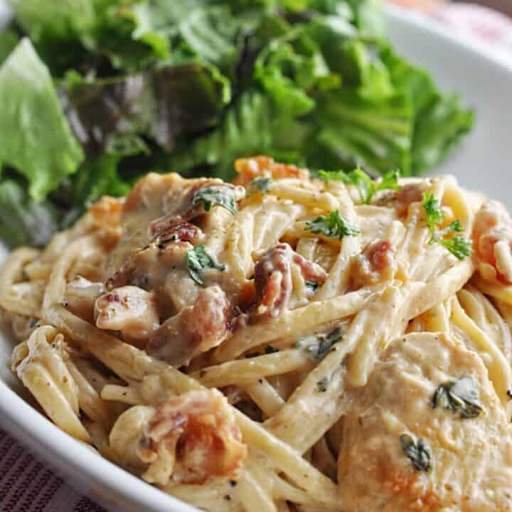 Pasta with creamy sauce chicken and bacon